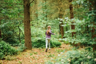Children exploring woodland