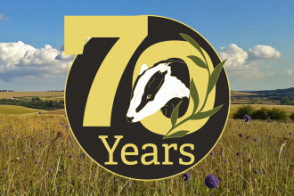 70 years wild logo over photo of Red Hill nature reserve